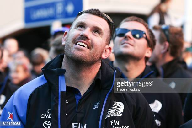 Cyclists Joe Sullivan and Simon van Velthooven look on during the Team New Zealand Americas Cup Wellington Welcome Home Parade on July 11 2017 in...