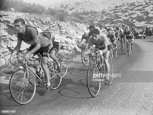 Cyclists Louison Bobet and Jean Mallejac near the end of the 15th stage in the 1953 Tour de France | Location Between Nimes and Marseille France