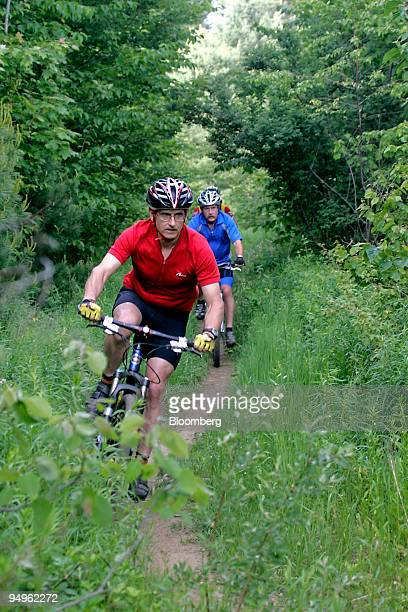 Cyclists make their way along the Kingdom Trails in East Burke Vermont US on Wednesday June 17 2009 Kingdom Trails features 100 miles of mountain...