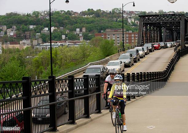 Cyclists move faster than the traffic backed up on the Hot Metal Bridge crossing the Monongahela River