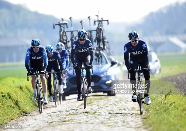 Cyclists of Britain's Sky team ride on cobblestones in Haveluy near Wallers northern France on April 11 2019 during a reconnaissance ride ahead of...