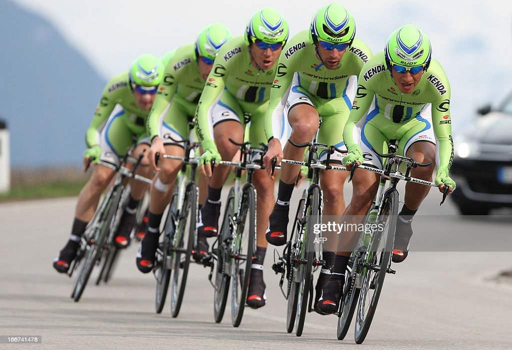 Cyclists of Cannondale Pro Cycling Team with Italian's leader Ivan Basso ride during the Team Time Trial of 14.1 km of the cycling road race 'Giro del Trentino' in Lienz, on April 16, 2013.