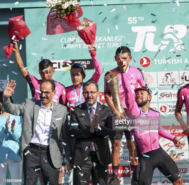 Cyclists of Manzana Postobon team celebrate on the podium after winning the 55th Presidential Cycling Tour of Turkey as they flanked by Turkish Youth...