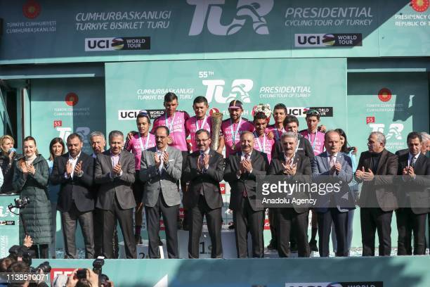 Cyclists of Manzana Postobon team pose for a photo on the podium with Turkish Youth and Sports Minister Mehmet Muharrem Kasapoglu after winning the...