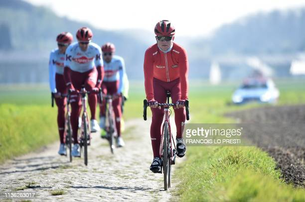 Cyclists of Switzerland's Katusha Alpecin team ride on cobblestones in Haveluy near Wallers northern France on April 11 2019 during a reconnaissance...