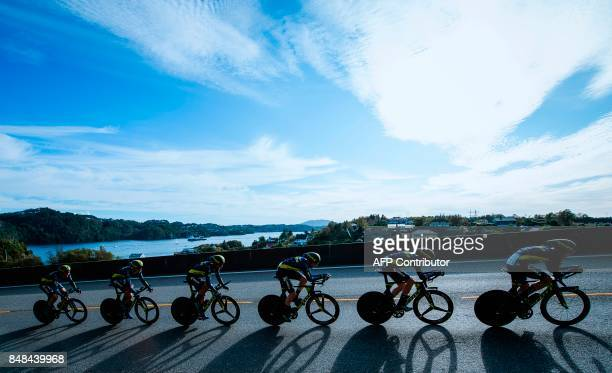Cyclists of team Orica Scott compete during the men's team time trial at the UCI Cycling Road World Championships on September 17 2017 in Bergen...