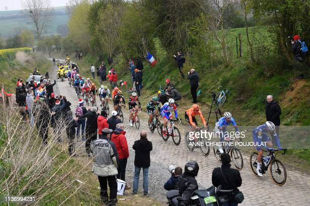 Cyclists of the front of the race ride on the Briastre to Viesly cobbled sector during the 117th edition of the Paris-Roubaix one-day classic cycling...