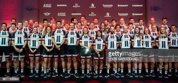 Cyclists of the Sunweb cycling team including Giro winner Tom Dumoulin of the Netherlands pose on stage during the team's official presentation on...