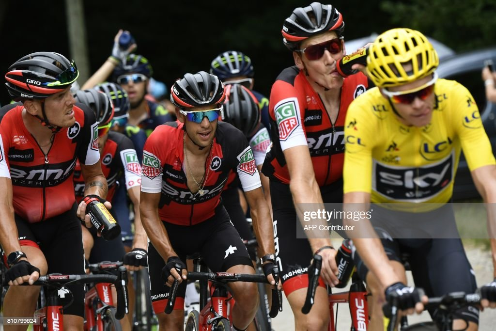 Cyclists of the USA's BMC Racing cycling team (From L) Italy's Alessandro De Marchi, Australia's Richie Porte and Switzerland's Stefan Kung ride behind Great Britain's Christopher Froome (R) wearing the overall leader's yellow jersey, during the 187,5 km eighth stage of the 104th edition of the Tour de France cycling race on July 8, 2017 between Dole and Station des Rousses. /