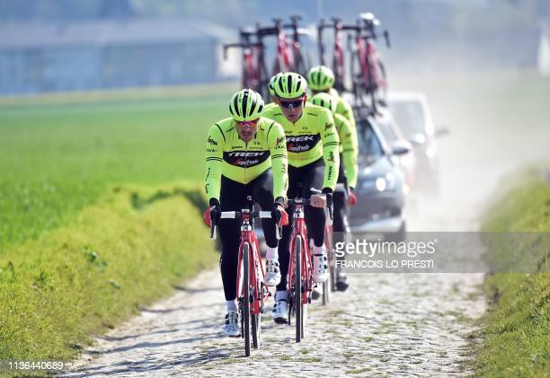 Cyclists of US' Trek-Segafredo team ride on cobblestones in Haveluy, near Wallers, northern France, on April 12, 2019 during a reconnaissance ride...