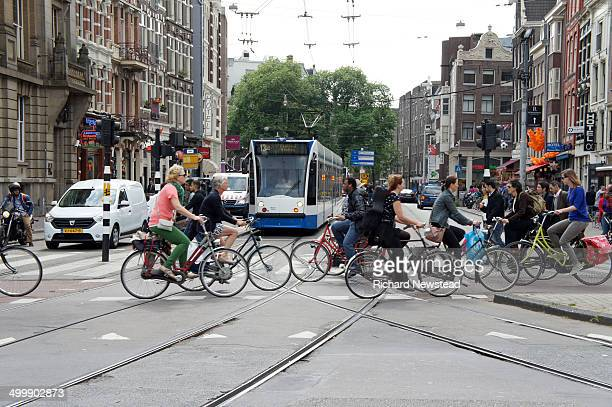 Cyclist's on a bicycle crossing in Amsterdam