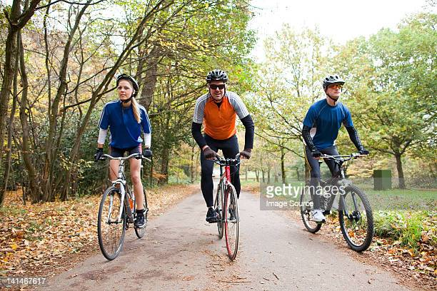 Cyclists on path in park