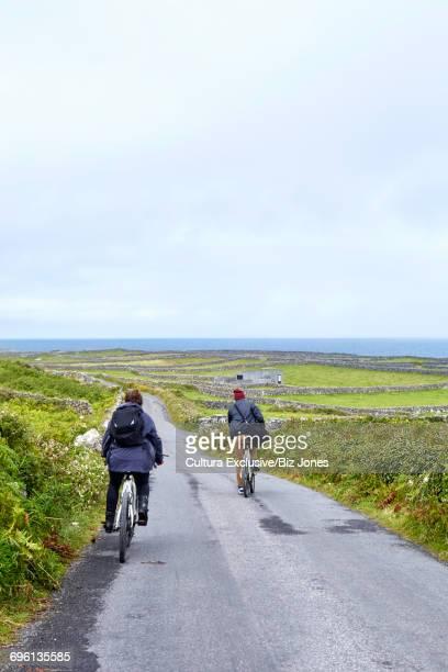 Cyclists on road, Inishmore, Ireland