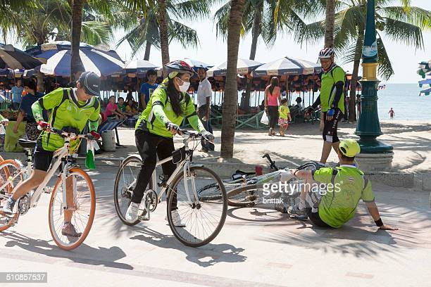 Cyclists on the beach in Bang Saen, Thailand, one overturned.