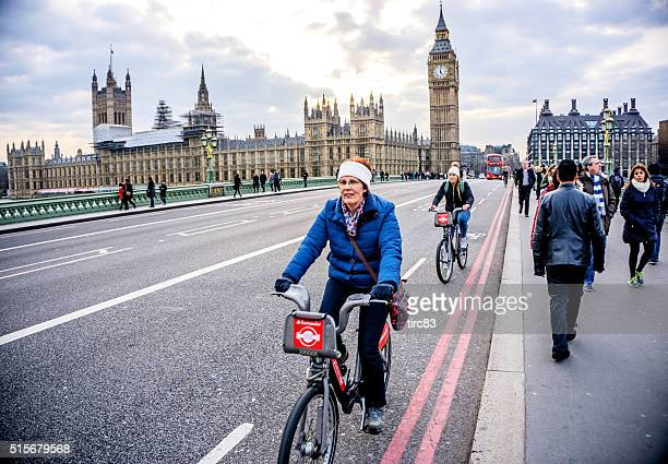 cyclists on westminster bridge big ben behind - westminster bridge stock pictures, royalty-free photos & images