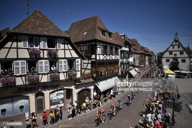 Cyclists oof the pack ride during the fifth stage of the 106th edition of the Tour de France cycling race between Saint-Die-des-Vosges and Colmar,...