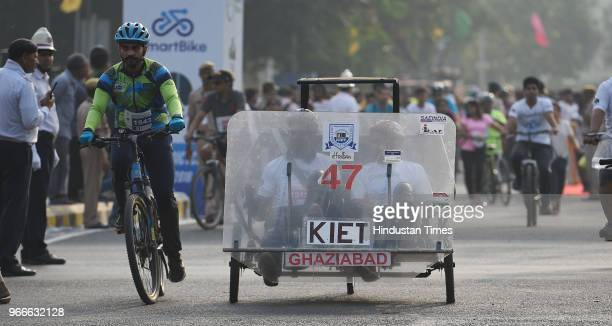Cyclists participate in a cycle rally on an improvised cycle on the occasion of World Bicycle Day 2018 after Vice President Venkaiah Naidu unveiled...