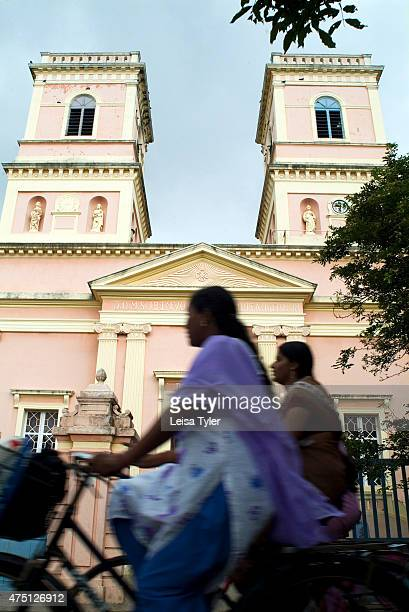 Cyclists pass a Frenchera church in Pondicherry otherwise known as Puducherry in Tamil Nadu India The tiny French colony in Indias remote southern...