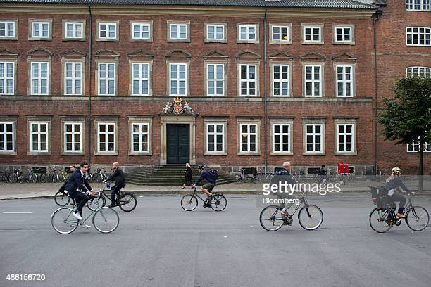 Cyclists pass the Danish Ministry of Finance building center in Copenhagen Denmark on Tuesday Sept 1 2015 'There are no areas' of the budget 'that...
