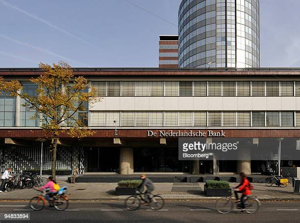 Cyclists pass the Dutch National bank in Amsterdam The Netherlands on Monday Oct 13 2008 The Dutch government will make 20 billion euros available to...