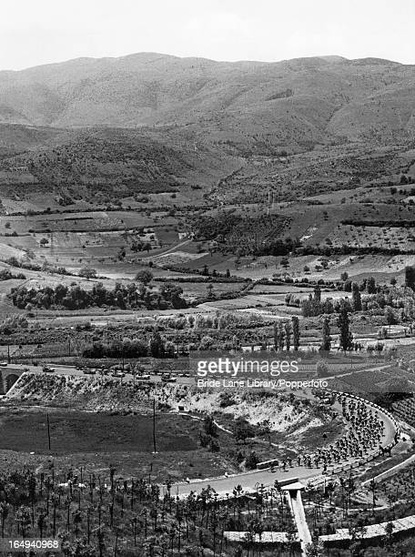 Cyclists pass through a valley in Lazio during the 5th lap of the Tour of Italy between Pescara and Rieti 25th May 1960