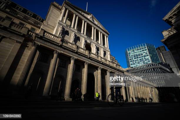 A cyclists passes the Bank of England in the City of London UK on Thursday Feb 7 2019 The BOE warned that damage to the economy from Brexit has...