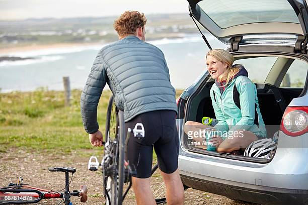 Cyclists preparing bicycle for ride