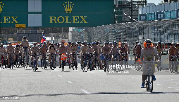 Cyclists race down the main straight of the Formula One Australian Grand Prix circuit at Albert Park as they take part in the World Naked Bike Ride...