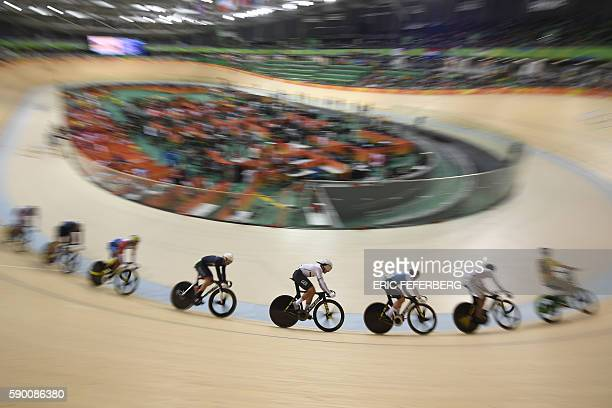 TOPSHOT Cyclists race during heat 4 of the Men's Keirin qualifying track cycling event at the Velodrome during the Rio 2016 Olympic Games in Rio de...
