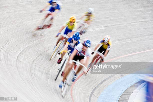 Cyclists racing around a circuit in a velodrome