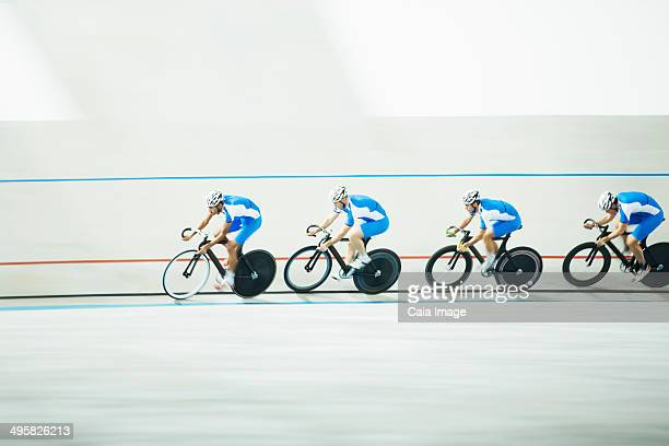 Cyclists racing around velodrome