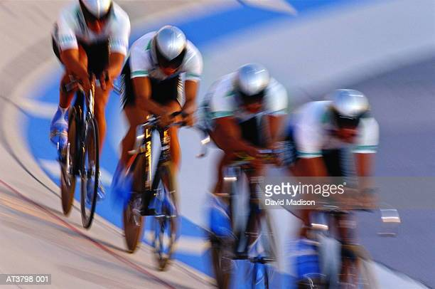 Cyclists racing in velodrome (blurred motion)