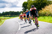 Cyclists racing on country roads.