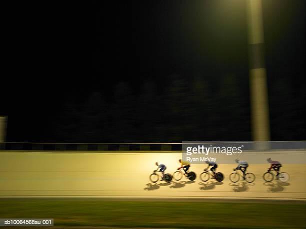 Cyclists racing on velodrome