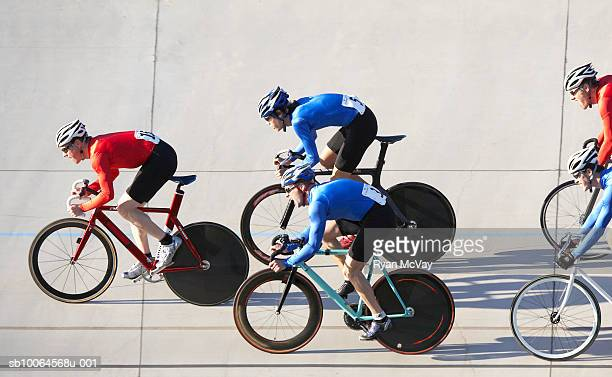cyclists racing, side view - sports race stock pictures, royalty-free photos & images