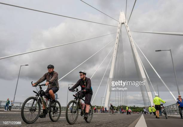 Cyclists ride across the new Northern Spire bridge spanning the River Wear as it opens for a pedestrian walkover on August 28 2018 in Sunderland...