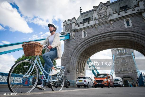 Cyclists ride across Tower Bridge during the evening rush hour on July 28, 2020 in London, England. Prime Minister Boris Johnson has announced a...