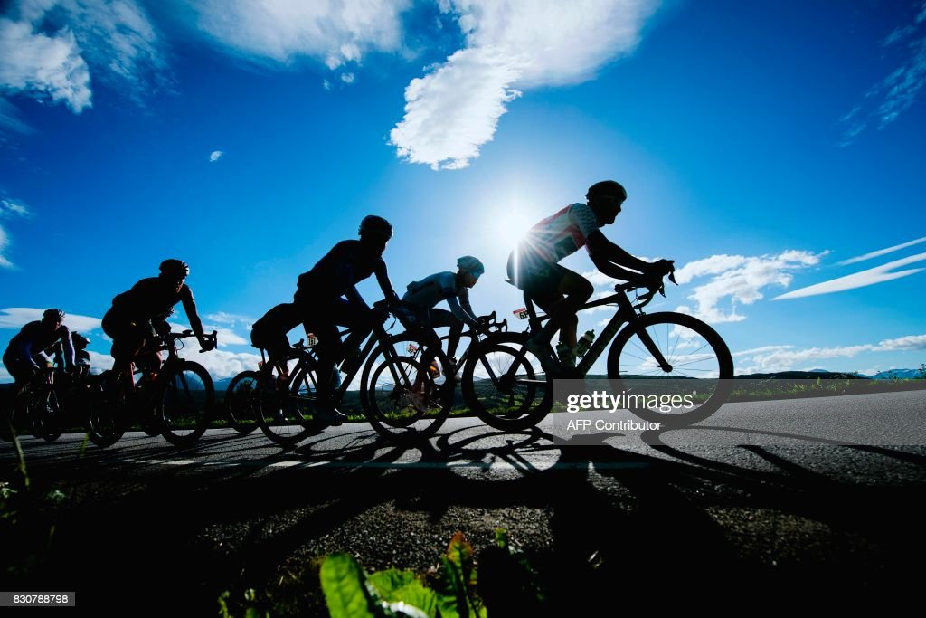 TOPSHOT - Cyclists ride ahead of the peloton during the 185,5 km third stage of the Arctic Race of Norway between Lyngseidet and Finnvikdalen near Tromso in Norway on August 12, 2017. / AFP PHOTO / Jonathan NACKSTRAND