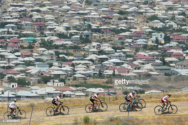Cyclists ride along a ridgeline during the Womens' Crosscountry Mountain Bike Cycling during day one of the Baku 2015 European Games at Mountain Bike...