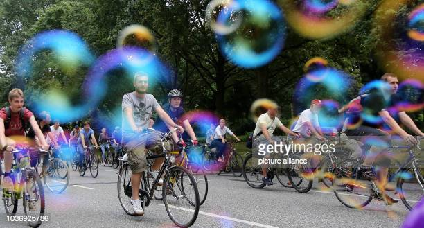 Cyclists ride along a street during a so called 'Critical Mass' in Hamburg Germany 25 July 2014 The participants of the 'Critical Mass' appeal to the...