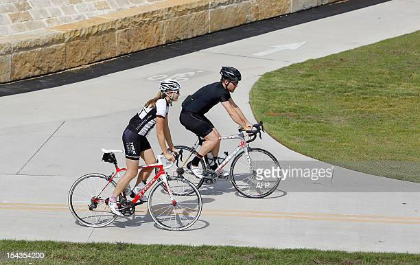 Cyclists ride along the 'Lance Armstrong Bikeway' on October 18 2012 in Austin Texas Anticancer charity Livestrong founder cyclist Lance Armstrong...