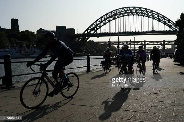 Cyclists ride along the quayside next to the River Tyne in Newcastle on September 17 2020 in Newcastle upon Tyne England Almost two million people in...
