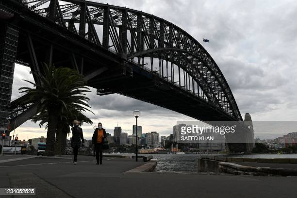 Cyclists ride along the quiet walkway along Harbour Bridge in Sydney on July 19 amid a lockdown in Melbourne and Sydney as Australia seeks to contain...