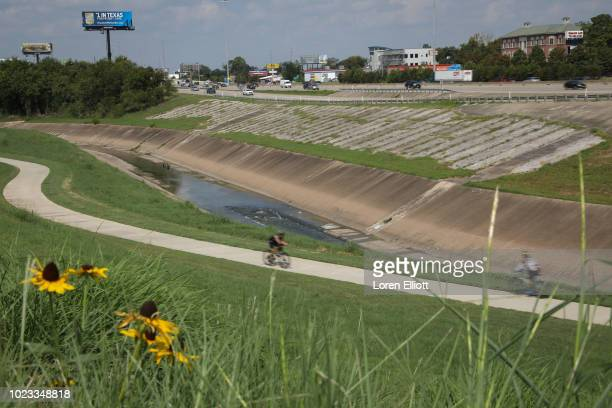 Cyclists ride along White Oak Bayou Trail on August 25 2018 in Houston Texas August 25 is the oneyear anniversary of when Hurricane Harvey made...