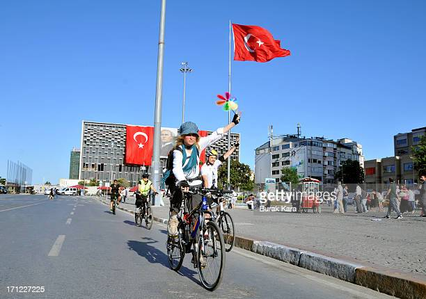 Cyclists ride bikes during the silent protest at Taksim Square on June 23 2013 in Istanbul Turkey Performance artist Erdem Gunduz nicknamed 'The...