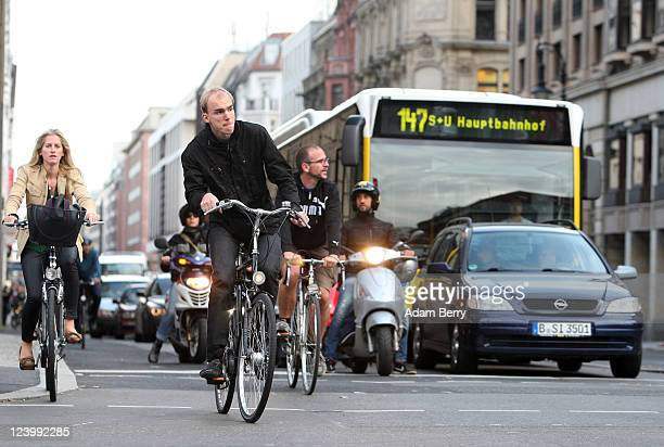 Cyclists ride down Friedrichstrasse amongst traffic in the Mitte district on September 7 2011 in Berlin Germany