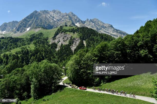 TOPSHOT Cyclists ride during the 115 km eighth stage of the 69th edition of the Criterium du Dauphine cycling race on June 11 2017 between...