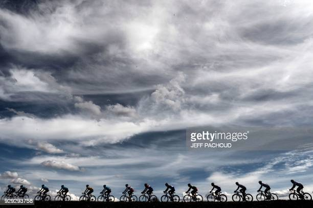 TOPSHOT Cyclists ride during the 165km fifth stage of the 76th ParisNice cycling race between Salon de Provence and Sisteron on March 8 2018 / AFP...