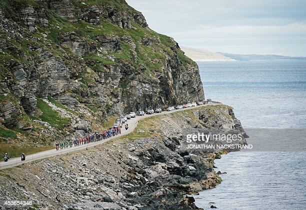 Cyclists ride during the 207 km second stage of the Arctic Race of Norway between Honningsvag and Alta in Norway on August 15 2014 AFP PHOTO/JONATHAN...