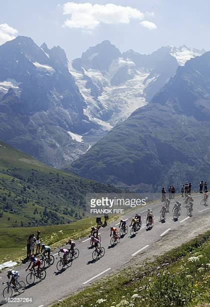 cyclists ride during the eighth stage of the 90th Tour de France cycling race between Sallanches and l'Alpe d'Huez 13 July 2003 AFP PHOTO FRANCK FIFE
